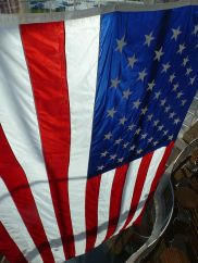 640px-Flag_of_the_United_States_at_the_Flint_Hills_Discovery_Center_in_Manhattan,_KS