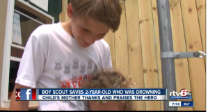 Victim hugs his scout-lifesaver